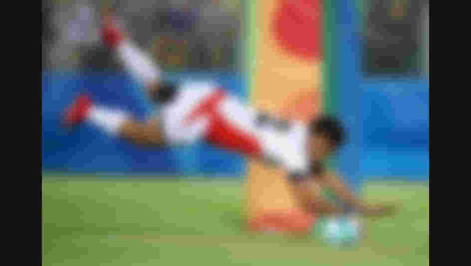 Kazuhiro Goya of Japan dives to score a try during the Men's Rugby Sevens Bronze medal final match between Japan and South Africa on Day 6 of the Rio 2016 Olympics.