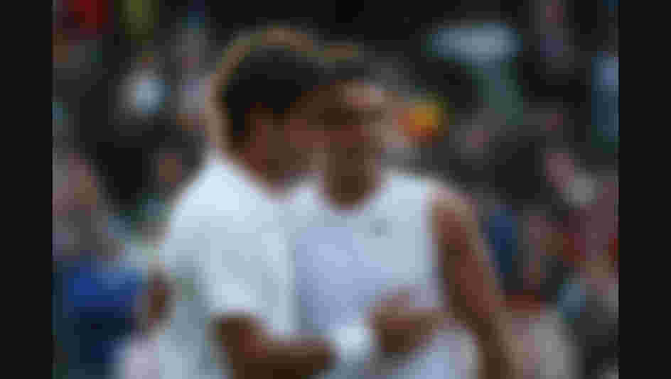 Roger Federer of Switzerland congratulates Rafael Nadal of Spain in winning match point and the Championship during the men's singles Final at Wimbledon in 2008  (Photo by Ryan Pierse/Getty Images)