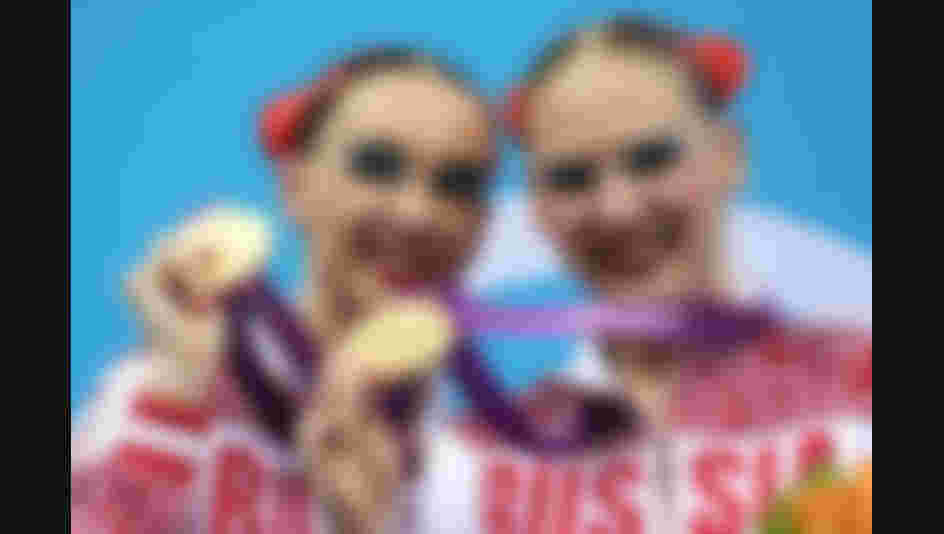 LONDON, ENGLAND - AUGUST 07:  Gold medallists Natalia Ishenko and Svetlana Romashina of Russia pose on the podium following the medal ceremony for the Women's Duets Synchronised Swimming Free Routine Final on Day 11 of the London 2012 Olympic Games at the Aquatics Centre on August 7, 2012 in London, England.  (Photo by Clive Rose/Getty Images)