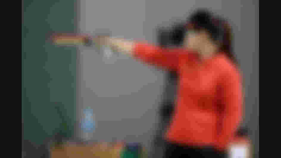 Mengxue Zhang of China competes during the Women's 10m Air Pistol event during the shooting competition on Day 2 of the Rio 2016 Olympic Games.