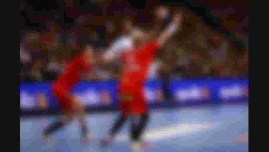 Melvyn Richardson of France shoots while he is challenged by Rasmus Lauge and Anders Zachariassen of Denmark during the 2019 IHF Men's World Championship semi-final (Photo by Martin Rose/Bongarts/Getty Images)