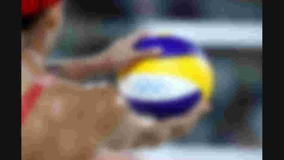 Jamie Lynn Broder of Canada holds the ball during the Women's Beach Volleyball Preliminary Pool D match against Laura Ludwig and Kira Walkenhorst of Germany on Day 4 of the Rio 2016 Olympic Games.