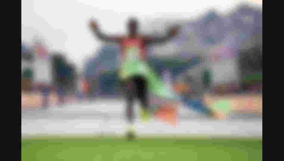 Eliud Kipchoge of Kenya celebrates as he crosses the line to win gold during the Men's Marathon on Day 16 of the Rio 2016 Olympic Games.
