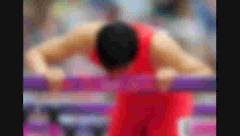 LONDON, ENGLAND - AUGUST 07:  Xiang Liu of China kisses a hurdle after getting injured in the Men's 110m Hurdles Round 1 Heats on Day 11 of the London 2012 Olympic Games at Olympic Stadium on August 7, 2012 in London, England.  (Photo by Stu Forster/Getty Images)