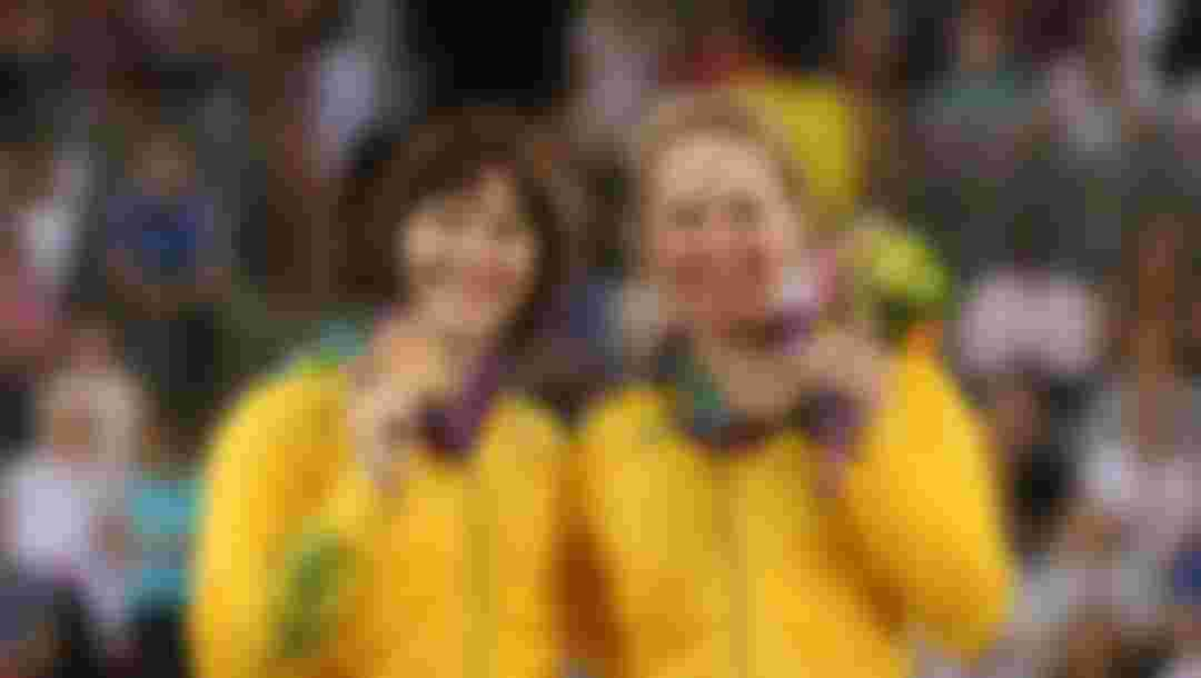 Bronze medallists Anna Meares and Kaarle Mcculloch of Australia pose with their medals during the medal ceremony for the Women's Team Sprint Track Cycling at the London 2012 Olympic Games (Photo by Bryn Lennon/Getty Images)