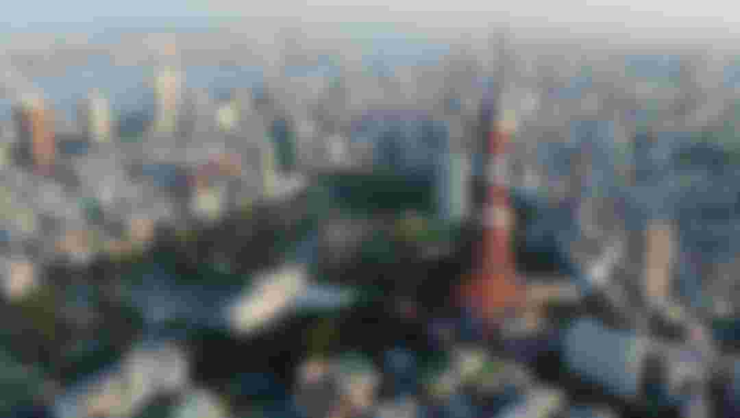 TOKYO, JAPAN - SEPTEMBER 12:  Aerial view of the Tokyo Tower and Tokyo bay area on September 12, 2013 in Tokyo, Japan. Tokyo was selected as the site of the 2020 Olympics.  (Photo by Atsushi Tomura/Getty Images)