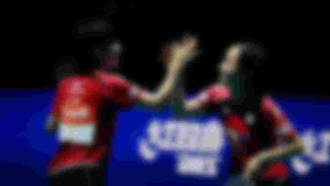 Hirano Miu (L) and Ito Mima (R) of Japan celebrate their win after defeating Feng Tian Wei and Yu Meng Yu of Singapore during the Women's Doubles semi-final at the 2014 ITTF World Tour Grand Finals