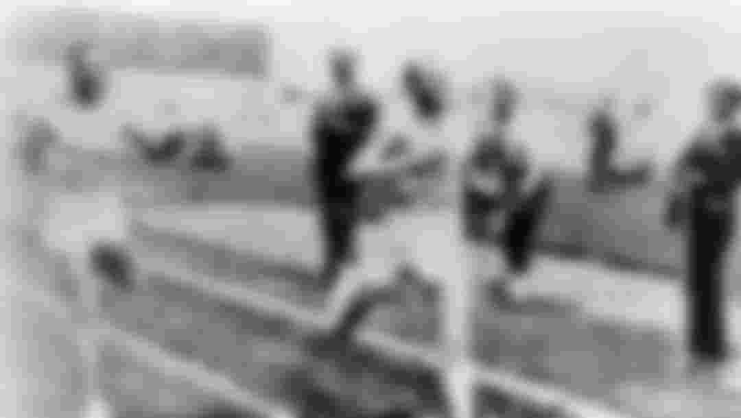 Paris 1924 OG, Athletics, 5000m Men - Final, Ville RITOLA (FIN) 2nd and Paavo NURMI (FIN) 1st crossing the finishing line.