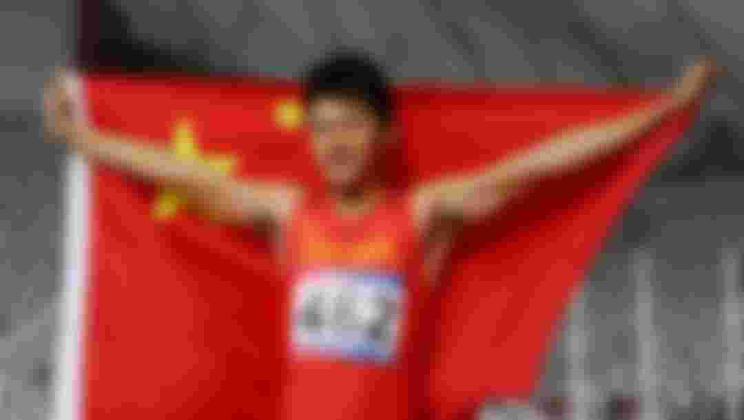 Xie Zhenye of China celebrates after winning the 200m Men final race during Day Four of the 23rd Asian Athletics Championships at Khalifa International Stadium in Doha, Qatar. (Photo by Francois Nel/Getty Images)