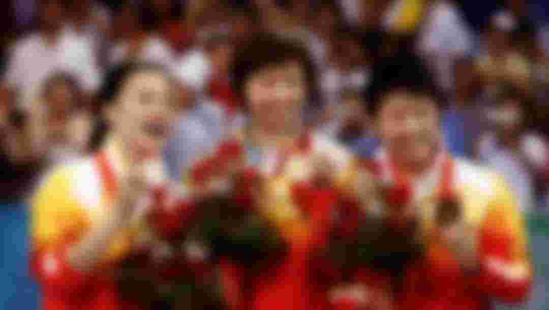 (L-R) Silver medalist Wang Nan of China, gold medalist Zhang Yining of China and bronze medalist Guo Yue of China stand on the podium during the medal ceremony for the Women's Singles Table Tennis Final at the Beijing 2008 Olympic Games on August 22, 2008 in Beijing, China.  (Photo by Jonathan Ferrey/Getty Images)