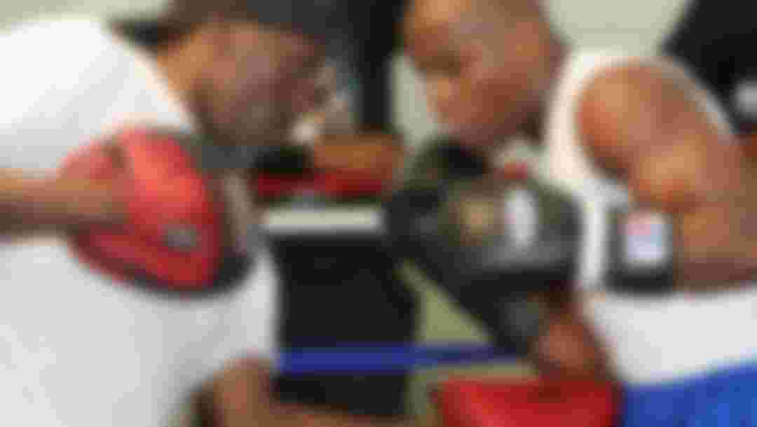 Boxer Floyd Mayweather Jr. (R) works out with his trainer and uncle Roger Mayweather in 2007.  (Photo by Ethan Miller/Getty Images)