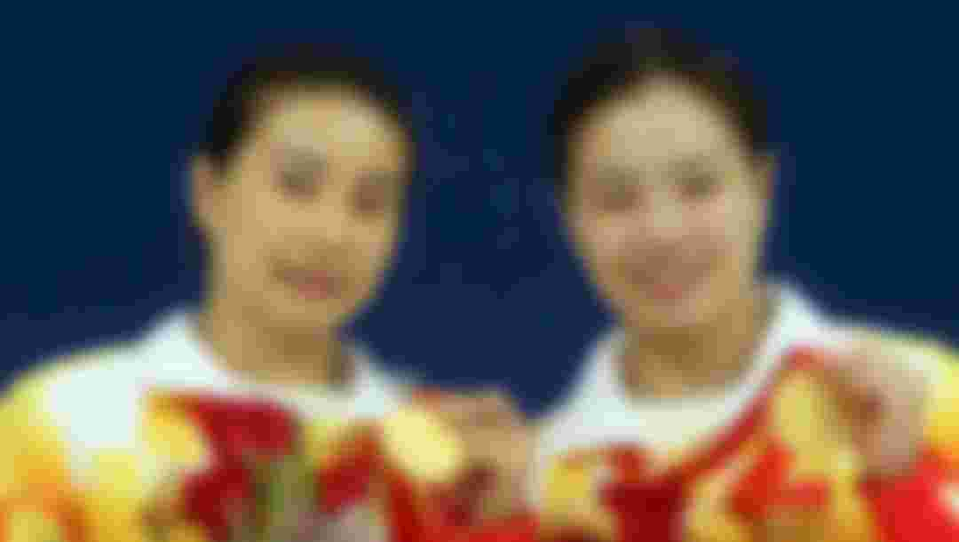 Guo Jingjing of China and Wu Minxia of China pose with their gold medal during the medal ceremony for the Women's Synchronized 3m Springboard event held at the National Aquatics Center during day 2 of the Beijing 2008 Olympic Games on August 10, 2008 in Beijing, China. (Photo by Al Bello/Getty Images)
