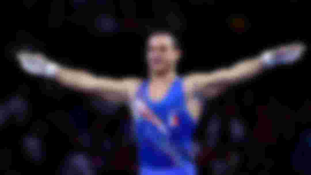 Samir Ait Said of France celebrates after his routine in Men's Rings Final during the 49th FIG Artistic Gymnastics World Championships in 2019 (Photo by Laurence Griffiths/Getty Images)