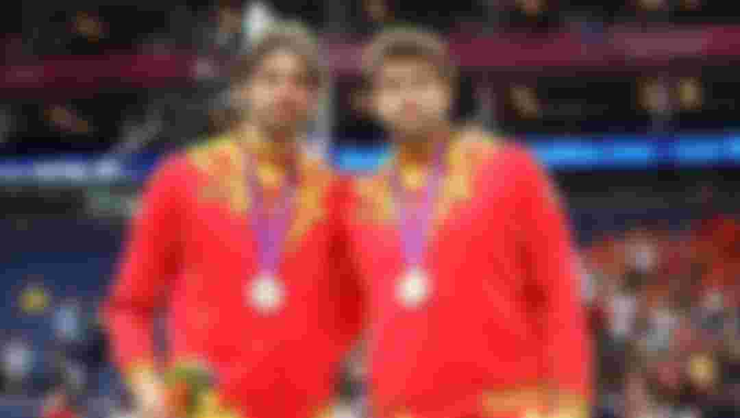 Silver medallist Pau Gasol of Spain and Marc Gasol of Spain pose on the podium during the medal ceremony for the Men's Basketball on Day 16 of the London 2012 Olympics Games at North Greenwich Arena on August 12, 2012 in London, England.  (Photo by Christian Petersen/Getty Images)