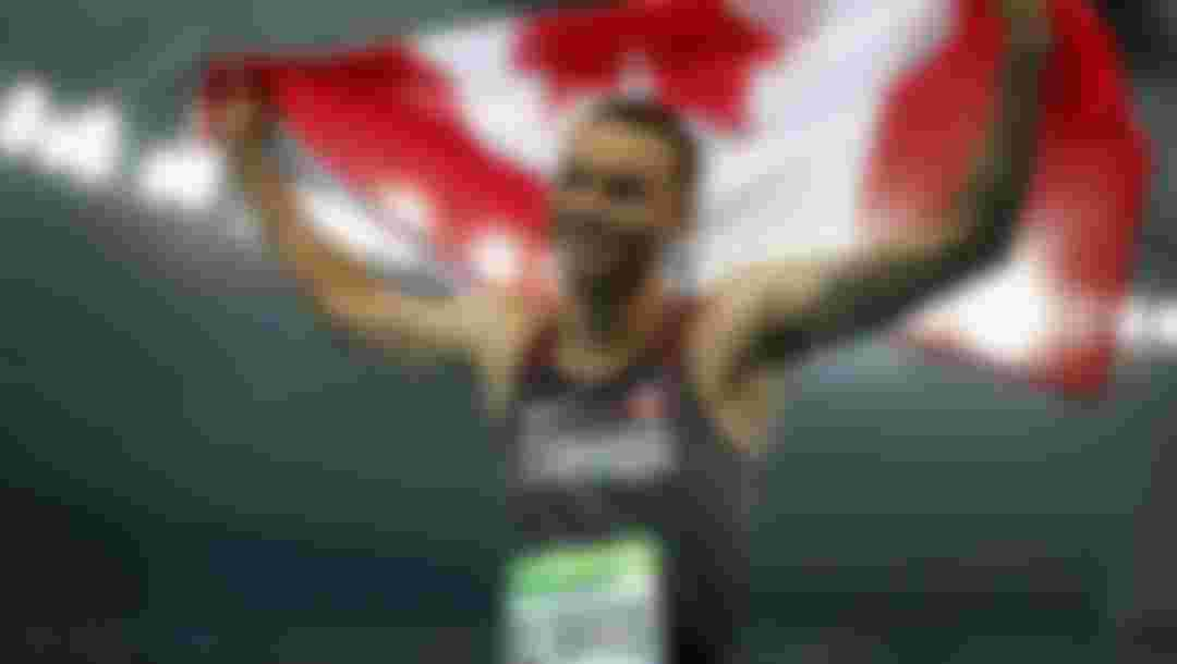 Andre De Grasse of Canada celebrates placing third after the Men's 100 meter final on Day 9 of the Rio 2016 Olympic Games.  (Photo by Paul Gilham/Getty Images)