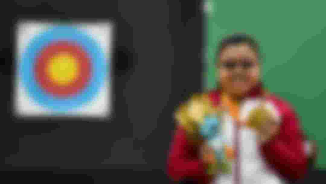 Gold medallist Jiamin Zhou of People's Republic of China celebrates on the podium at the medal ceremony for the Women's Archery Individual Compound Final at the Rio 2016 Paralympic Games.