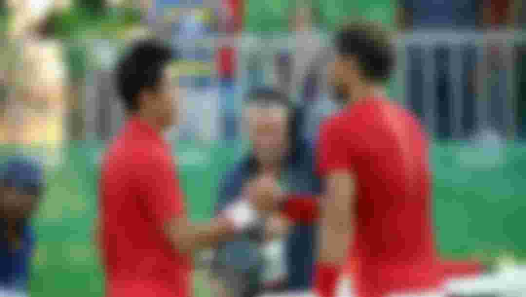 Kei Nishikori of Japan is congratulated by Rafael Nadal of Spain after winning the singles bronze medal match at the Rio 2016 Olympic Games