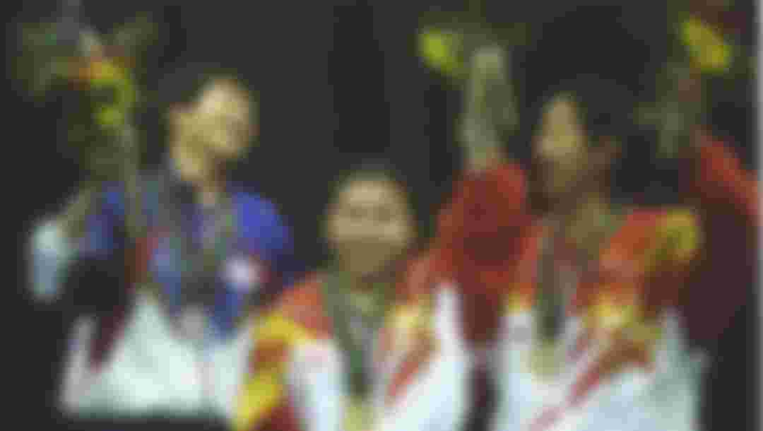 Medallists for the womens singles table tennis, L to R: Jing Cheng of Taipei, silver, Yaping Deng, gold, Hanmg Qiao of China, bronze, at the Georgia World Congress Centre at the Atlanta 1996 Centennial Olympic Games. Mandatory Cr