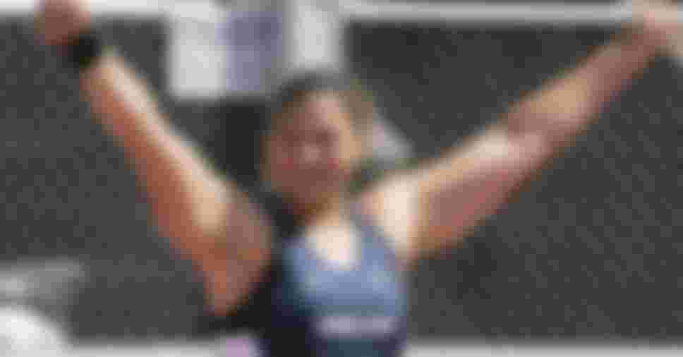 Valerie Adams (nee Vili) celebrates setting a national record during the Senior Women's Shot Put at the 2006 New Zealand track and field championships