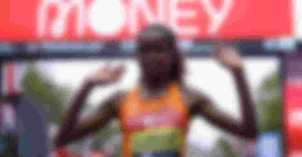 Brigid Kosgei of Kenya celebrates after winning in the Elite Women's Field during the 2020 London Marathon