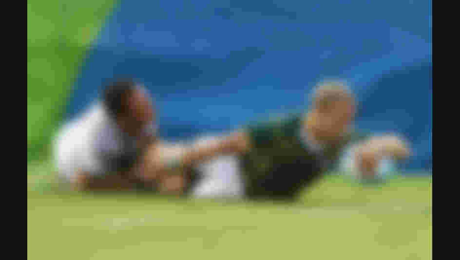 Kyle Brown of South Africa  holds off Manoel Dall Igna of France to score a try during the Men's Rugby Sevens Pool B match between South Africa and France on Day 4 of the Rio 2016 Olympic Games.