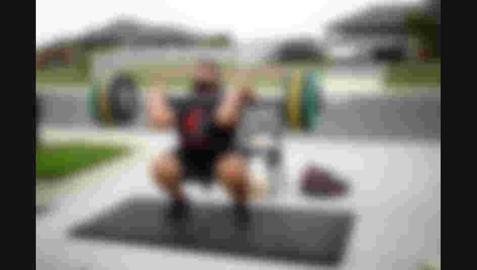 TE KAUWHATA, NEW ZEALAND - APRIL 08: New Zealand Weightlifter David Liti training in isolation on the road and driveway outside his home due to the Coronavirus lockdown on April 08, 2020 in Te Kauwhata, New Zealand. New Zealand has been in lockdown since Thursday 26 March following tough restrictions imposed by the government to stop the spread of COVID-19 across the country.  A State of National Emergency is in place along with an Epidemic Notice to help ensure the continuity of essential Government business. Under the COVID-19 Alert Level Four measures, all non-essential businesses are closed, including bars, restaurants, cinemas and playgrounds. Schools are closed and all indoor and outdoor events are banned. Essential services will remain open, including supermarkets and pharmacies. Lockdown measures are expected to remain in place for around four weeks, with Prime Minister Jacinda Ardern warning there will be zero tolerance for people ignoring the restrictions, with police able to enforce them if required. (Photo by Phil Walter/Getty Images)