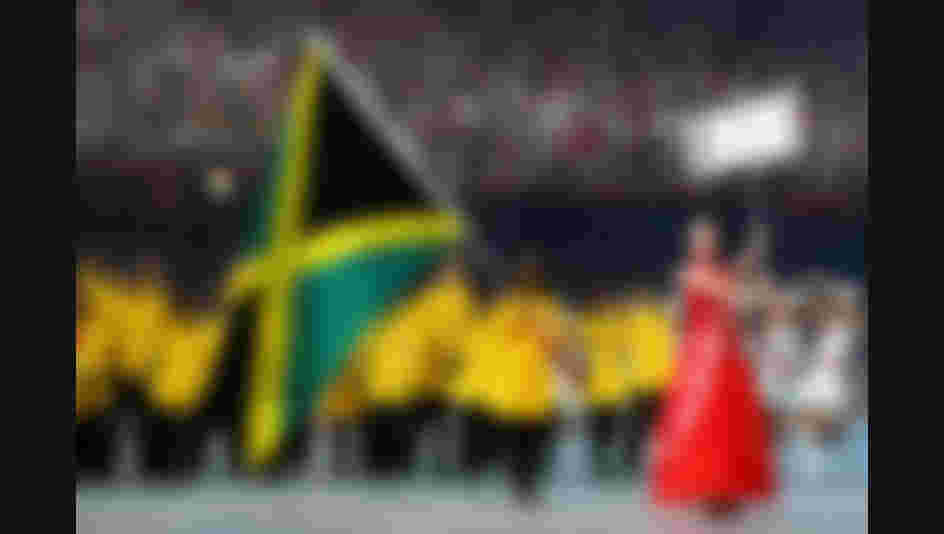 BEIJING - AUGUST 08:  Runner Veronica Campbell of Jamaica carries her country's flag to lead out the delegation during the Opening Ceremony for the 2008 Beijing Summer Olympics at the National Stadium on August 8, 2008 in Beijing, China.  (Photo by Paul Gilham/Getty Images)