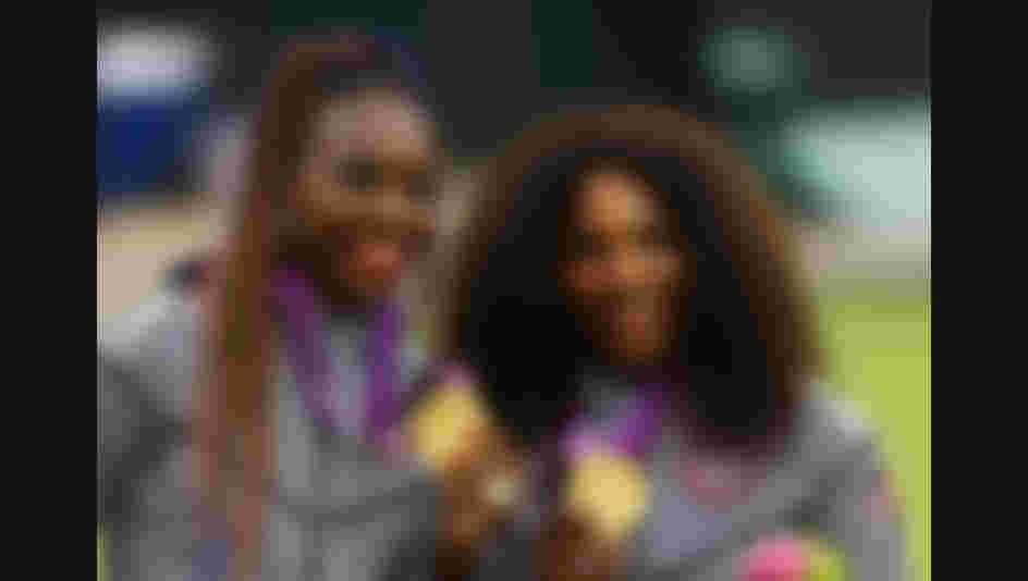 LONDON, ENGLAND - AUGUST 05:  Gold medalists Serena Williams of the United States and Venus Williams of the United States celebrate on the popdium during the medal ceremony for the Women's Doubles Tennis on Day 9 of the London 2012 Olympic Games at the All England Lawn Tennis and Croquet Club on August 5, 2012 in London, England.  (Photo by Paul Gilham/Getty Images)