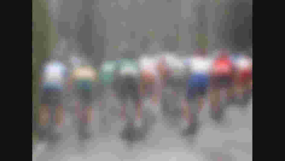 Riders cycle through water sprays at a cooling station as they compete in the Men's Road Cycling event during the Beijing 2008 Olympic Games (Photo by Jamie Squire/Getty Images)