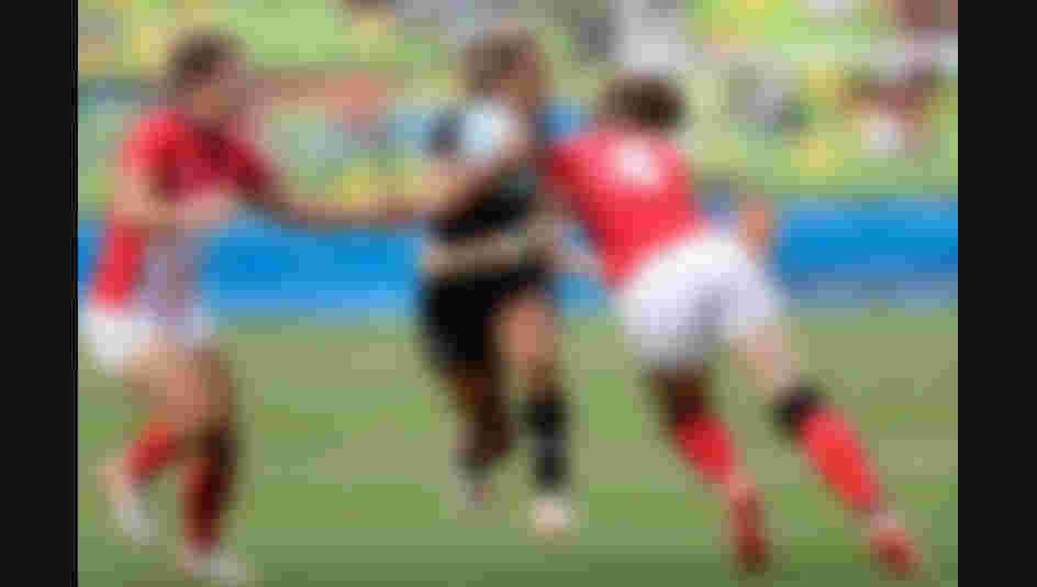 Huriana Manuel of New Zealand is tackled by Emily Scarratt of Great Britain during the Women's Semi Final 2 Rugby Sevens match between Great Britain and New Zealand on Day 3 of the Rio 2016 Olympic Games.