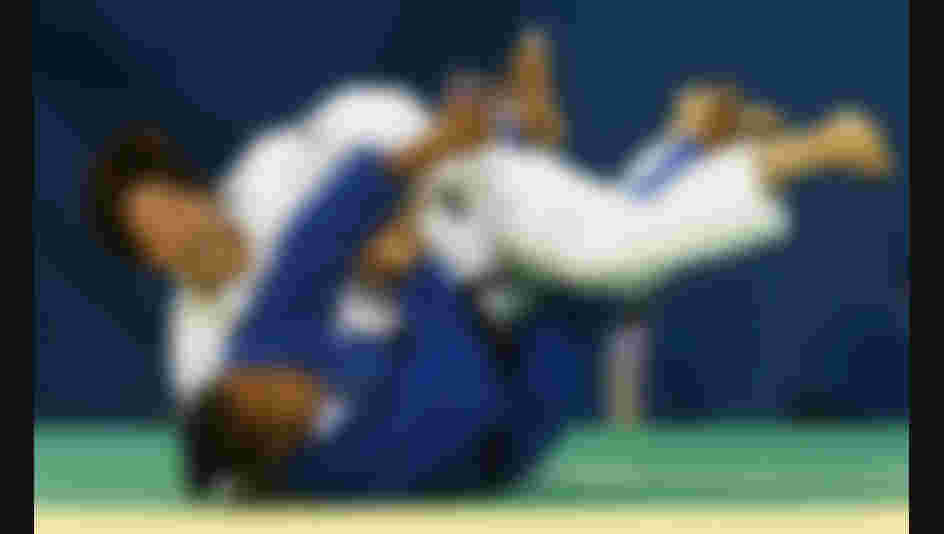 Tanoimoto Ayumi of Japan throws Lucie Decosse of France in the gold medal contest of the 63kg judo bout at the Beijing 2008 Olympic Games (Photo by Lars Baron/Bongarts/Getty Images)