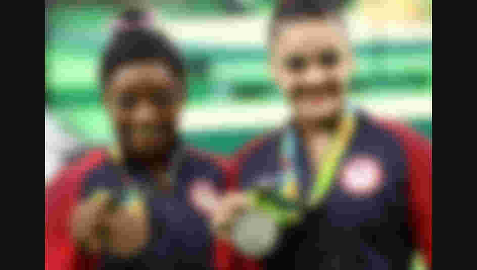 Bronze medallist Simone Biles (L) and silver medallist Lauren Hernandez (R) of the United States pose for photographs after the at the medal ceremony for the Balance Beam at the Rio 2016 Olympic Games (Photo by Lars Baron/Getty Images)