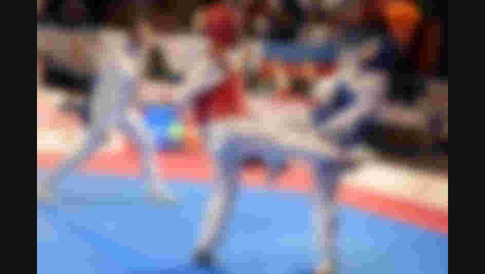 All images credit to World Taekwondo Federation - In this image you see a female fighter (red) with a attempt to kick a female fighter (blue) who defends and prepares her counter