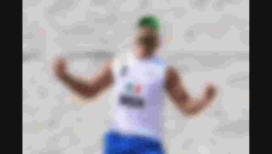 Juan Ramon Virgen Pulido of Mexico celebrates during the Men's Beach Volleyball of the Rio 2016 Olympic Games.  (Photo by Shaun Botterill/Getty Images)