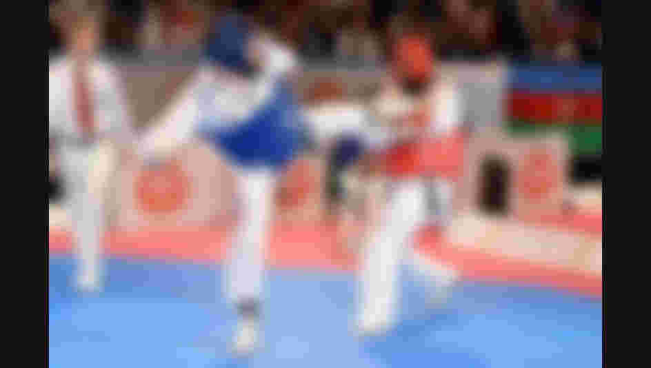 All images credit to World Taekwondo Federation - In this image you see a male fighter (blue) with kick to the chest of male fighter (red) who is unable to defend.