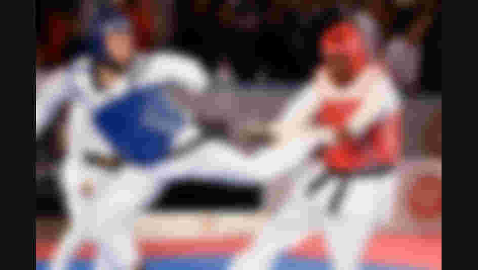 All images credit to World Taekwondo Federation - In this image you see a male fighter (blue) with kick to the chest of male fighter (red).