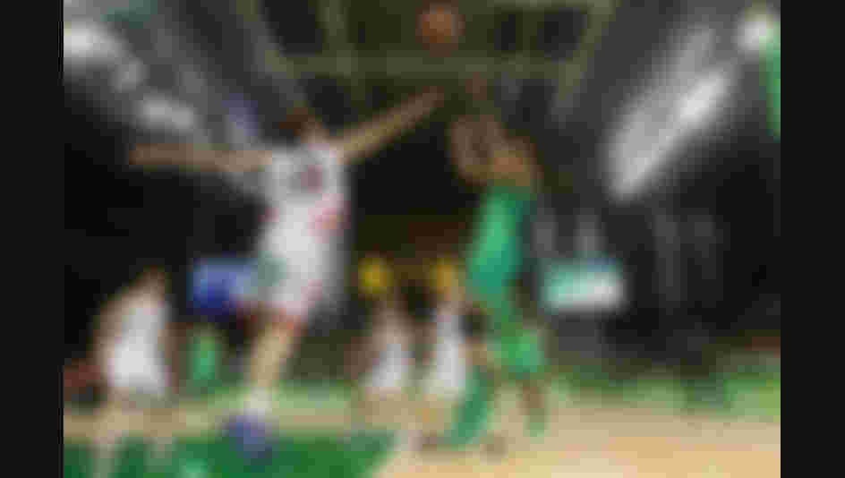 Iziane Marques #8 of Brazil puts up a shot over Ramu Tokashiki #10 of Japan during the women's basketball game on Day 3 of the Rio 2016 Olympic Games.