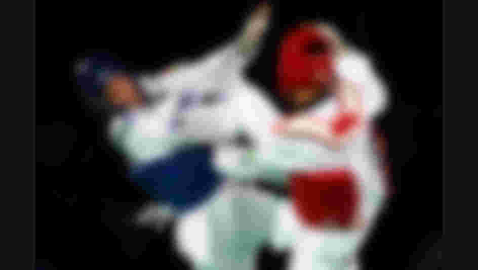 Radik Isaev of Azerbaijan competes against Rusian Zhaparov of Kazakhstan during Men's +80kg Taekwondo competition at the Rio 2016 Olympic Games.