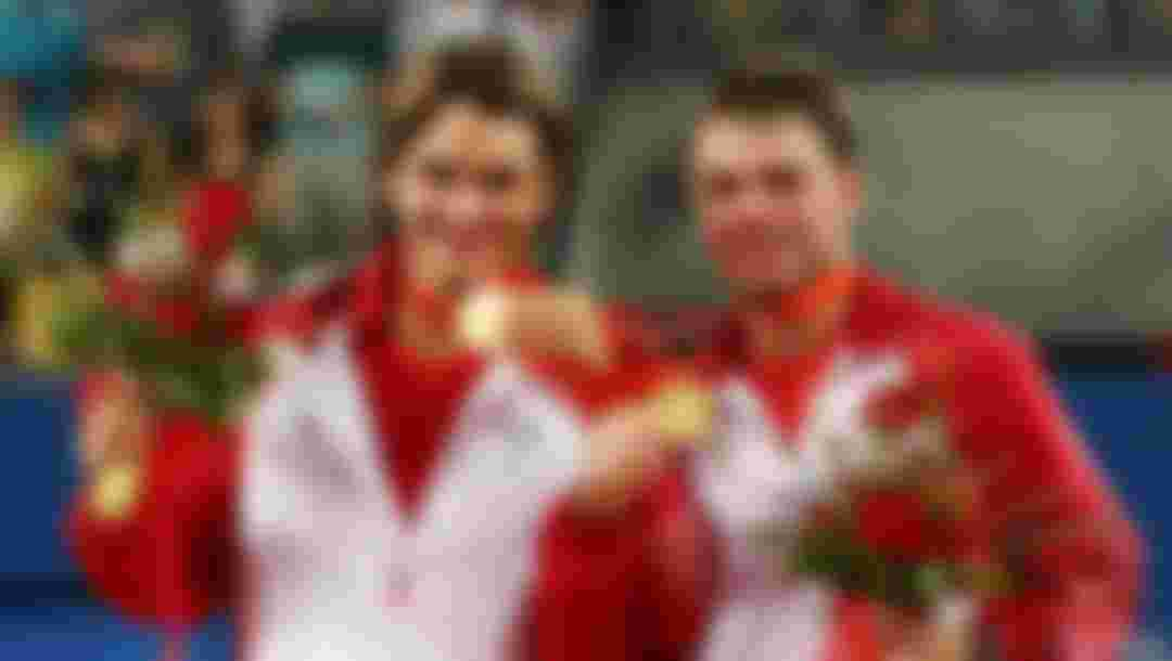 Roger Federer (left) and Stanislas Wawrinka of Switzerland receive their gold medals after defeating Thomas Johansson and Simon Aspelin of Sweden during the men's doubles gold medal tennis match at the Beijing 2008 Olympic Games (Photo by Clive Brunskill/Getty Images)