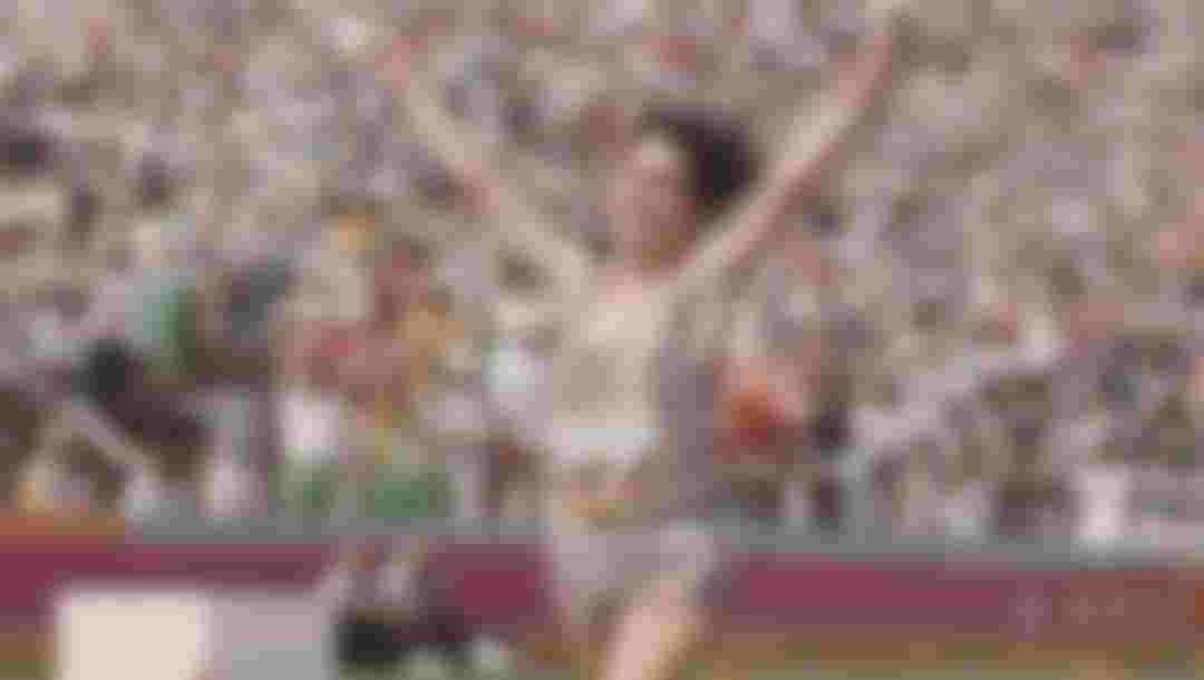 Joan Benoit of the United States raises her arms in celebration after winning the Women's marathon event at the XXIII Olympic Summer Games on 5 August 1984 at the Los Angeles Memorial Coliseum in Los Angeles, California, United States.  (Photo by Tony Duffy/Allsport/Getty Images)