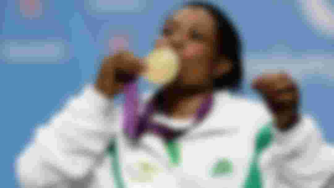 LONDON, ENGLAND - SEPTEMBER 01:  Gold medallist Esther Oyema of Nigeria kisses her medal during the medal ceremony for the women's -48 kg Powerlifting on day 3 of the London 2012 Paralympic Games at ExCel on September 1, 2012 in London, England.  (Photo by Matthew Lloyd/Getty Images)