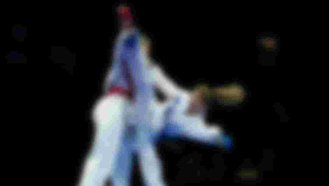 Two karateka battle it out during kumite