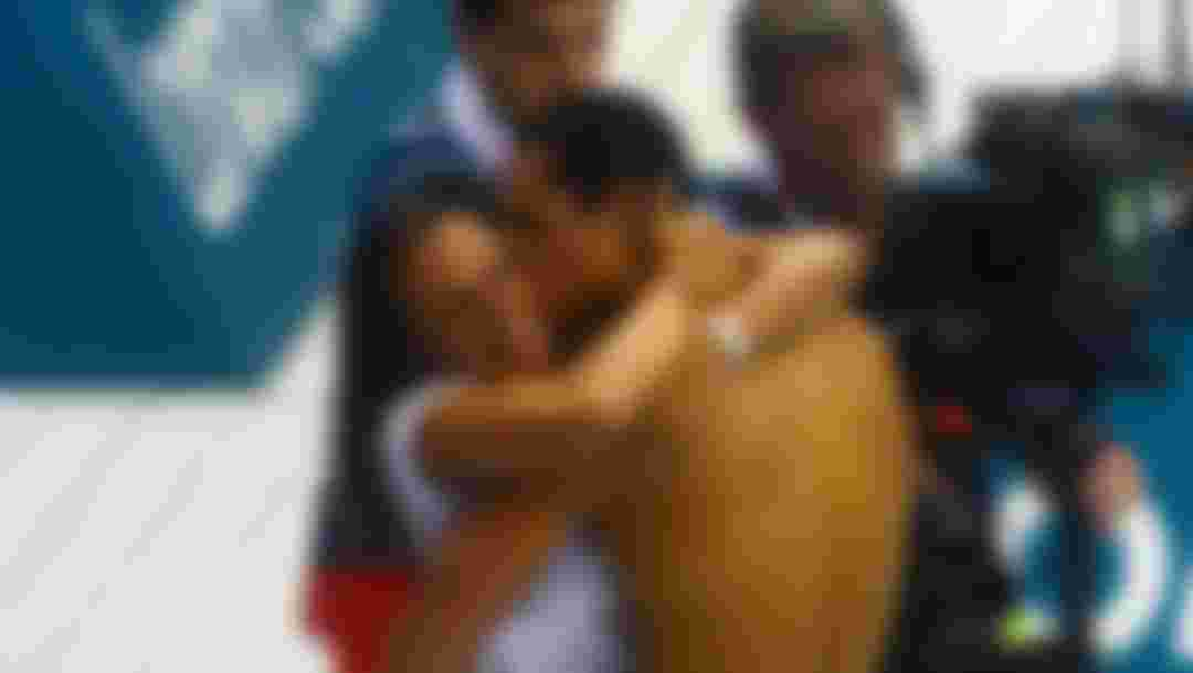 LONDON, ENGLAND - AUGUST 03:  Florent Manaudou of France embraces his sister  Laure Manaudou after winning the MenÂ's 50m Freestyle Final on Day 7 of the London 2012 Olympic Games at the Aquatics Centre on August 3, 2012 in London, England.