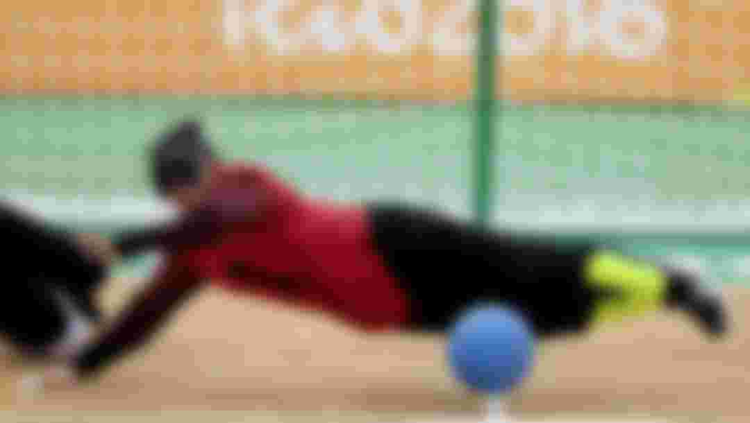 RIO DE JANEIRO, BRAZIL - SEPTEMBER 12: Fengqing Chen of China in action during Goalball - Women's Preliminary - Group D match between China and Canada at Future Arena on day 5 of the Rio 2016 Paralympic Games at  on September 12, 2016 in Rio de Janeiro, Brazil.  (Photo by Alexandre Loureiro/Getty Images)