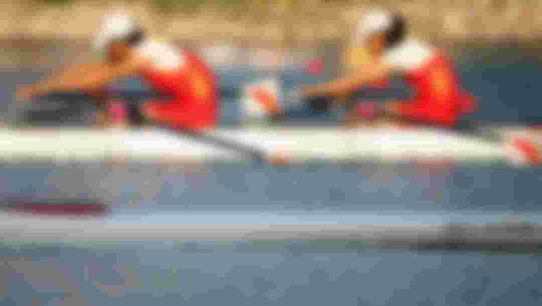 BEIJING - SEPTEMBER 11:  Zhou Yangjing and Shan Zilong of China who win the Gold complete in the Rowing Mixed Double Sculls - TA Final at Shunyi Olympic Rowing-Canoeing Park during day five of the 2008 Paralympic Games on September 11, 2008 in Beijing, China.  (Photo by Feng Li/Getty Images)