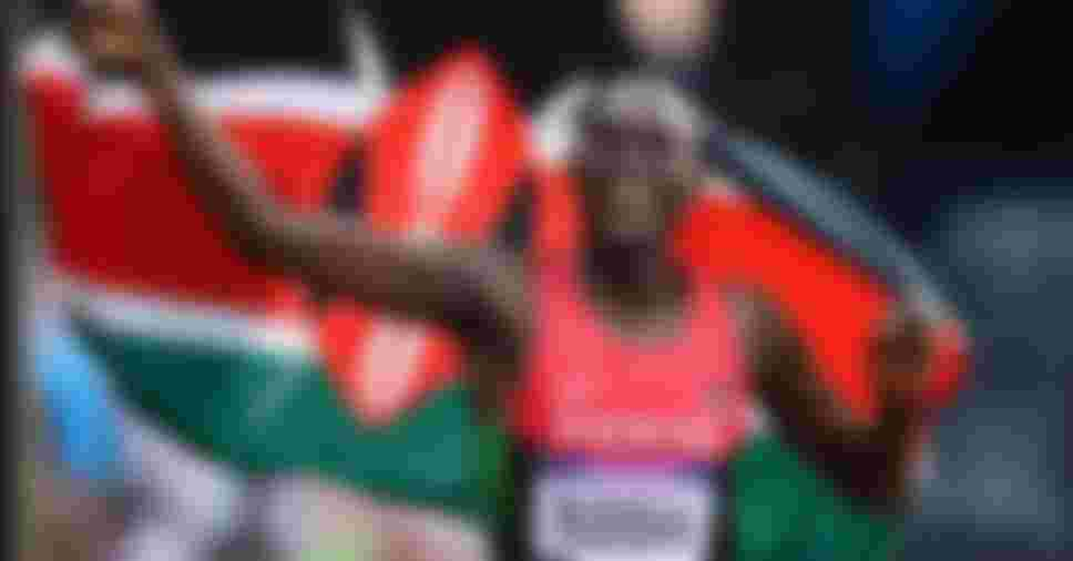 LONDON, ENGLAND - AUGUST 09:  David Lekuta Rudisha of Kenya celebrates with his country's national flag after winning gold and setting a new world record of 1.40.91 in the Men's 800m Final on Day 13 of the London 2012 Olympic Games at Olympic Stadium on August 9, 2012 in London, England.  (Photo by Mike Hewitt/Getty Images)