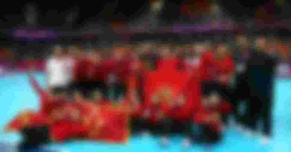 Silver medallist Montenegro pose during the medal ceremony for the Women's Handball Final at the London 2012 Olympics Games (Photo by Jeff Gross/Getty Images)